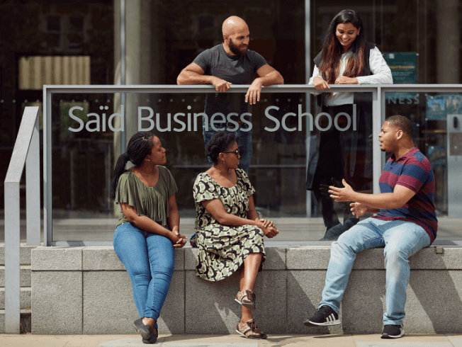 mba students sitting outside said business school