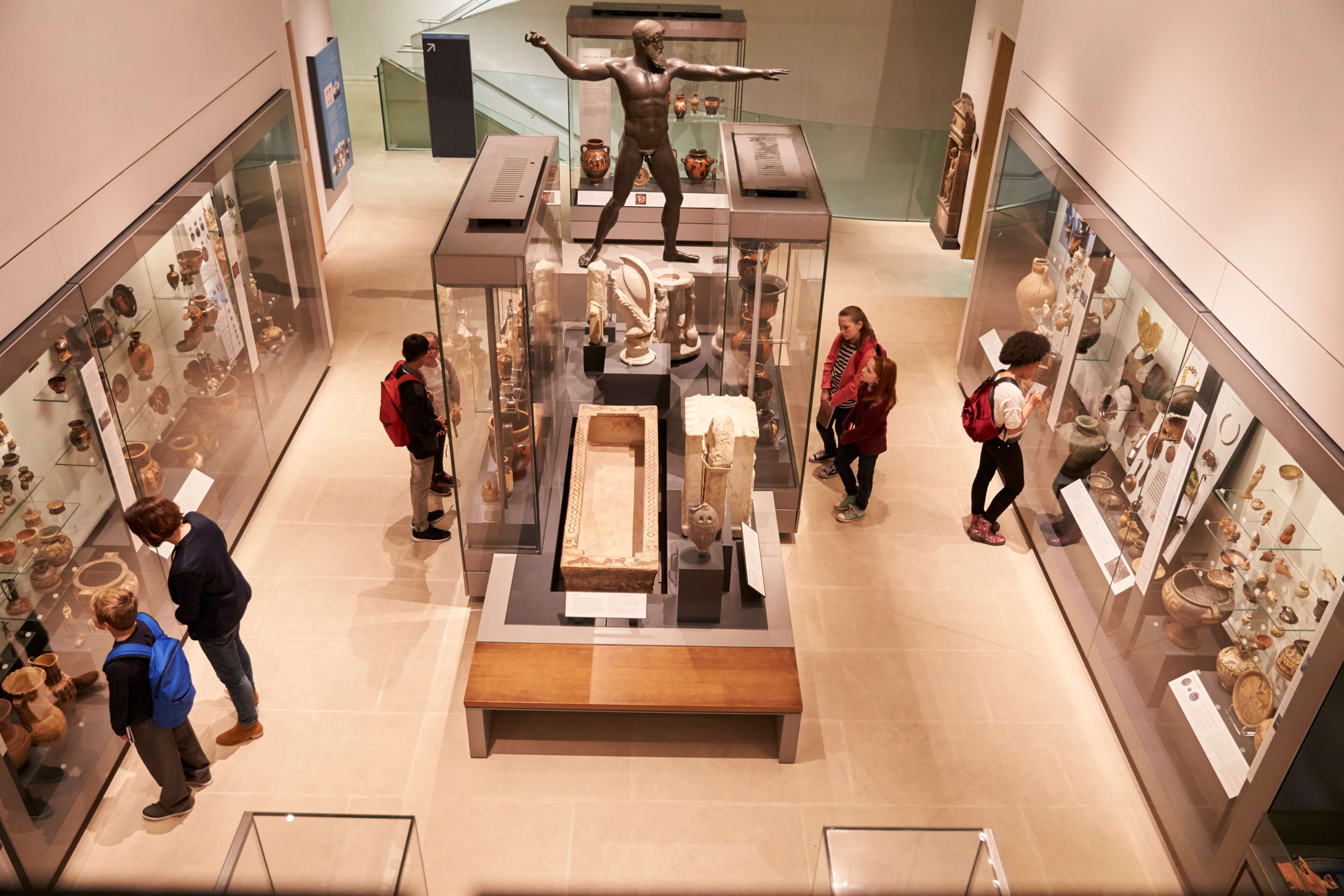 Visitors looking at objects in the Ashmolean Museum