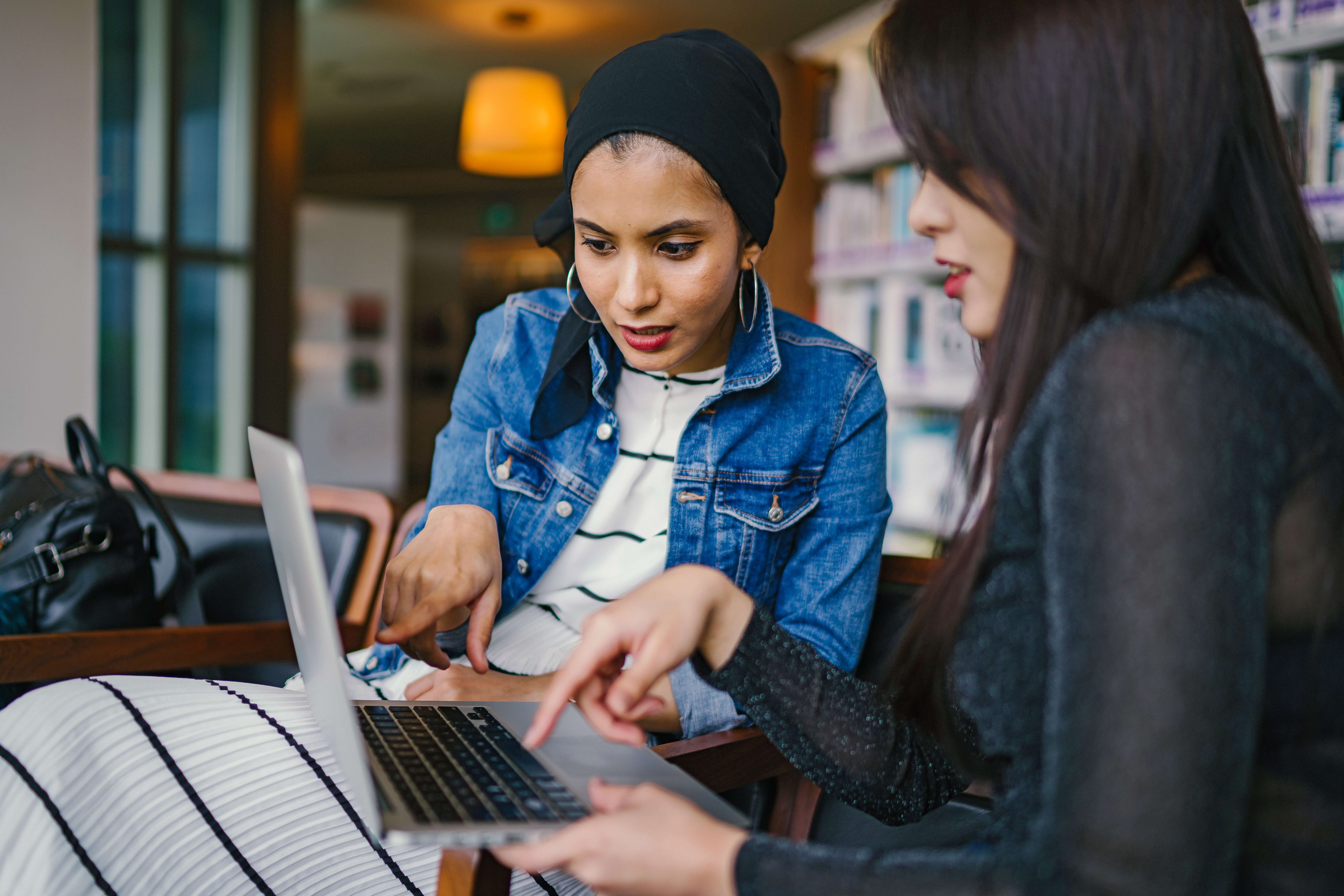 Women working together at a laptop