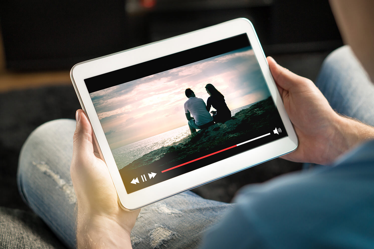 Watching a film on a tablet