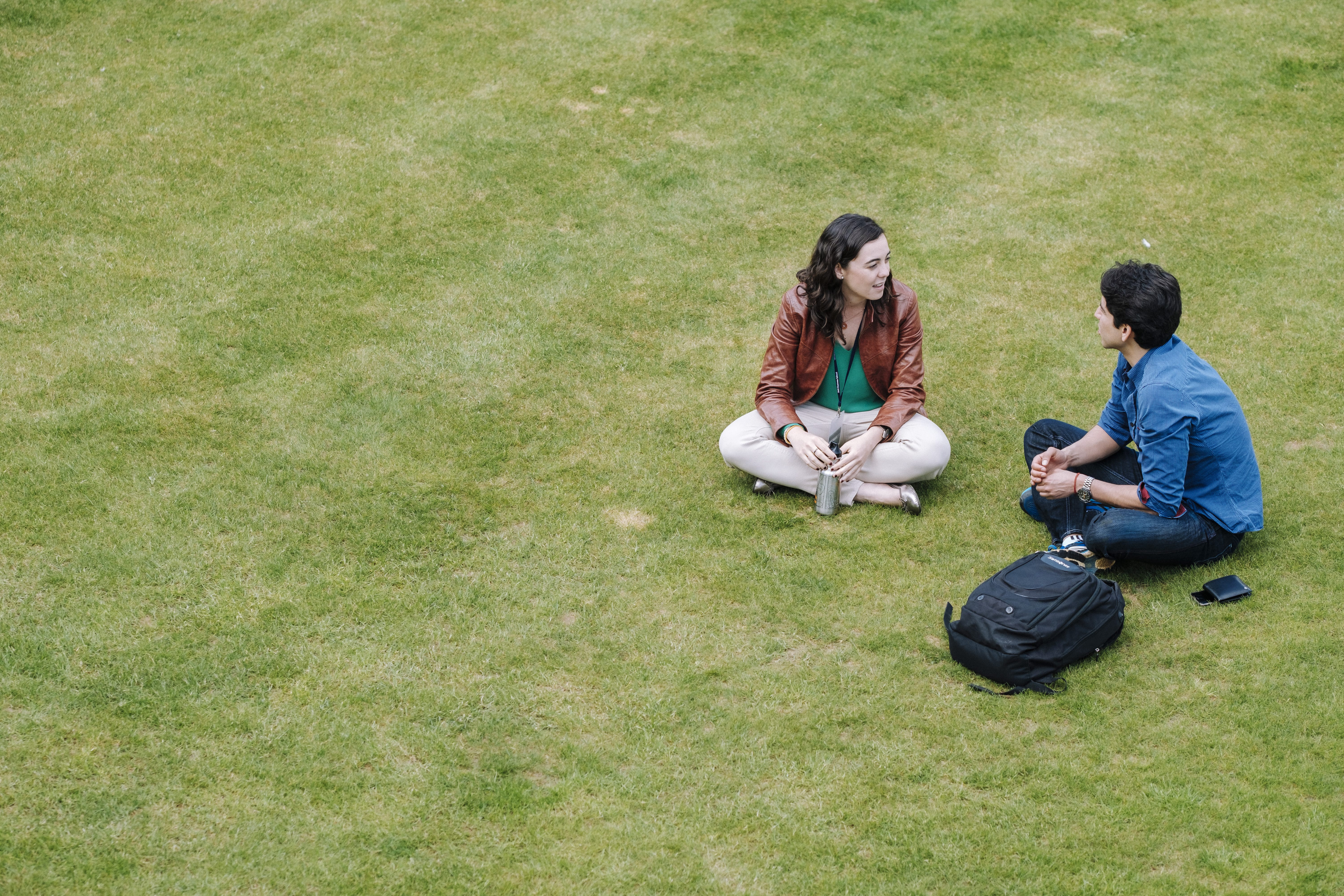 Students relaxing on grass