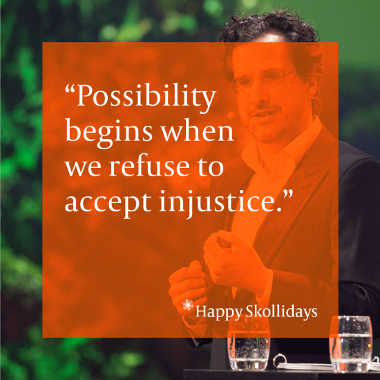 "Peter Drobac with a background of greenery, speaking on stage. The image has an orange overlay with the words: ""Possibility begins when we refuse to accept injustice"""