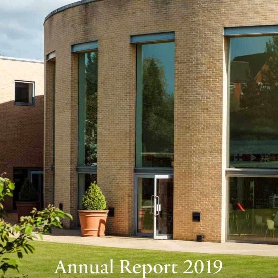 Annual report cover showing an Oxford Saïd Building