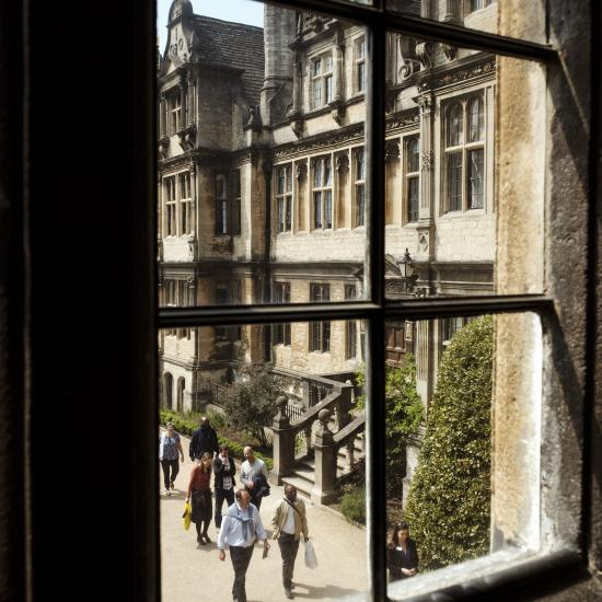 looking through window into college courtyard