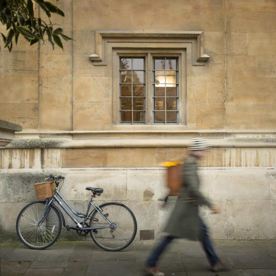 Oxford building with bicycle and pedestrian