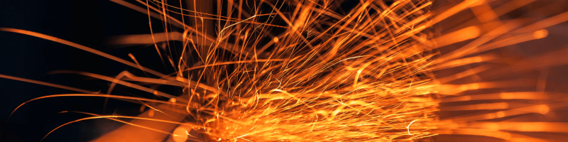 orange sparks with dark background