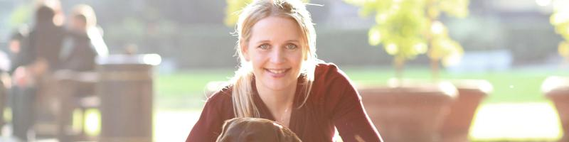 Rikke Rusenlund, founder of Borrow My Doggy with her dog