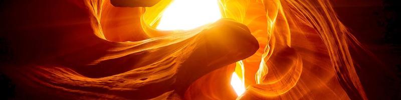 Photograph of the sun through a canyon