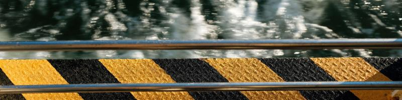 Warning stripes and guardrail (Photo by Florian Rieder on Unsplash)