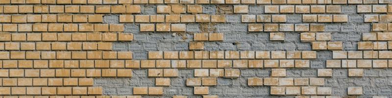 brick wall with bricks missing