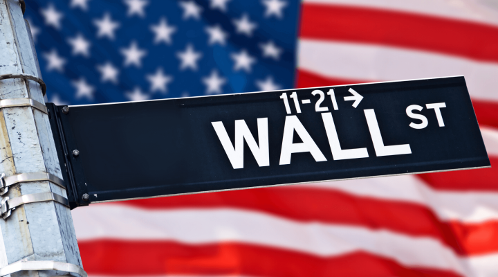 Wall Street sign and an American Flag