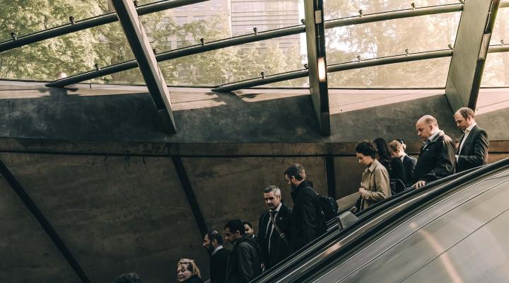 commuters on a subway escalator